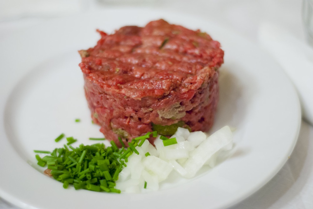 Steak tartare is prepared from finely chopped or minced raw beef ...